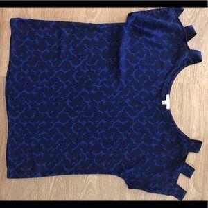 Blue short sleeve shirt with sleeve cutouts